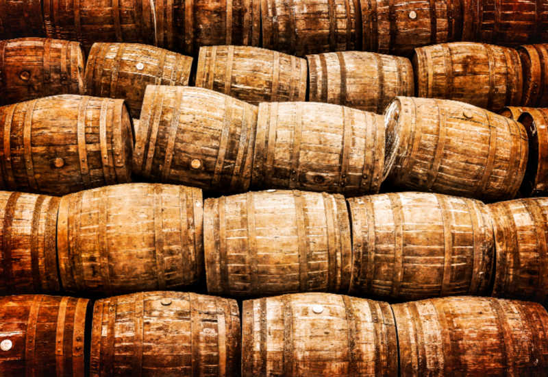 A huge pile of oak barrels.