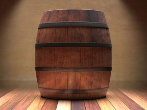 A whiskey barrel on a wooden floor